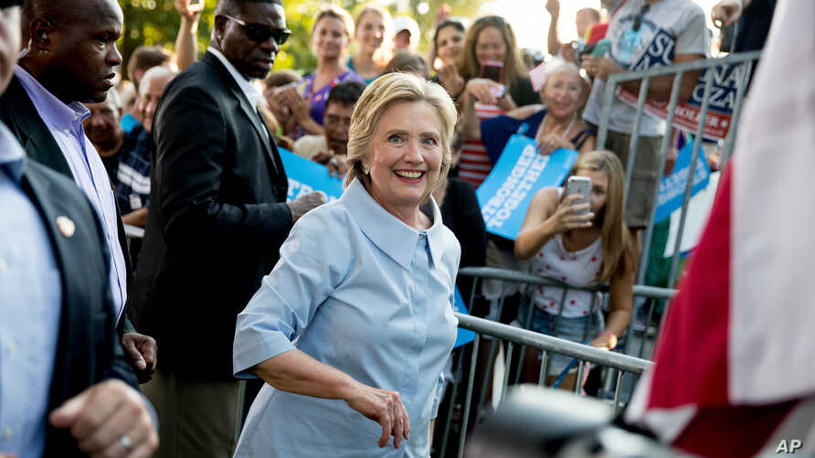 Democratic presidential candidate Hillary Clinton departs after speaking at the 49th Annual Salute to Labor at Illiniwek Park Riverfront in Hampton, Ill., Sept. 5, 2016.