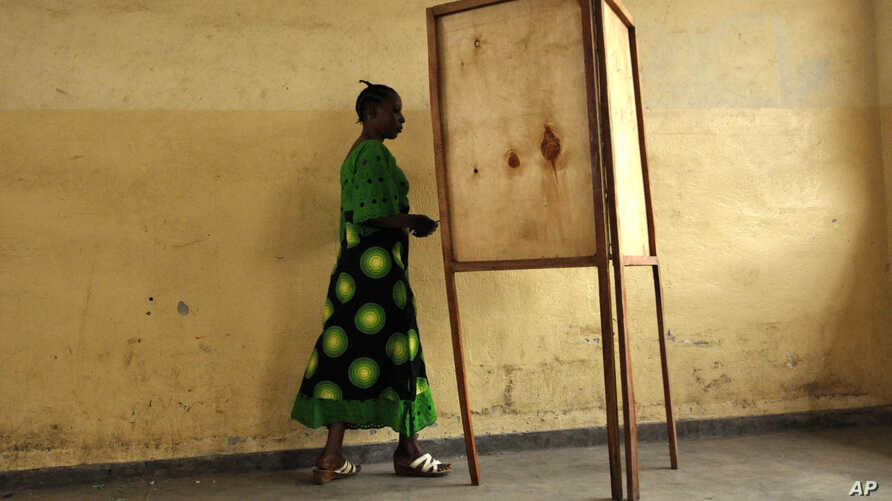 FILE - A voter walking towards a voting booth in Bujumbura, Burundi, as people prepared to vote in a presidential election, June 28, 2010.