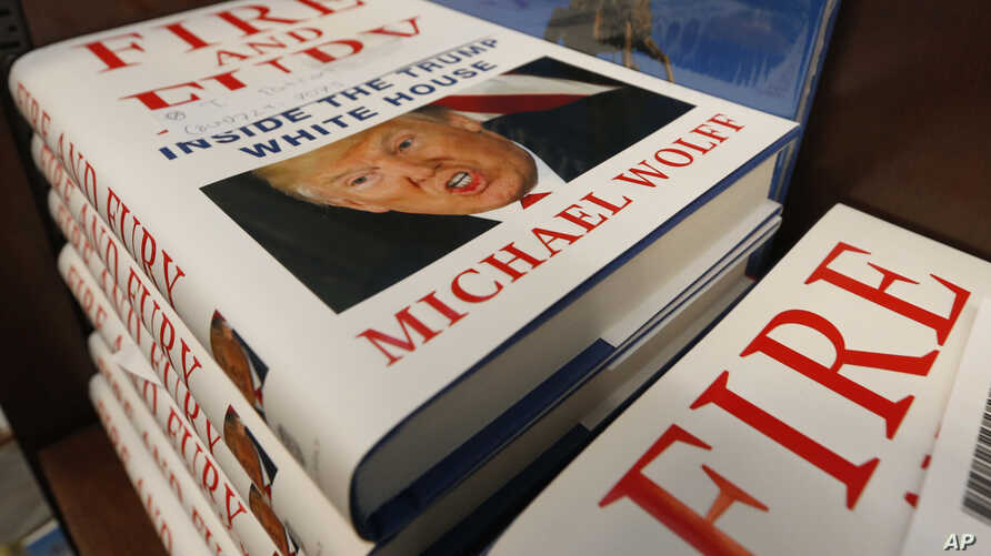 """A stack of reserved """"Fire and Fury"""" books by writer Michael Wolff sit on a shelf in a bookstore in Richmond, Va., Jan. 5, 2018."""