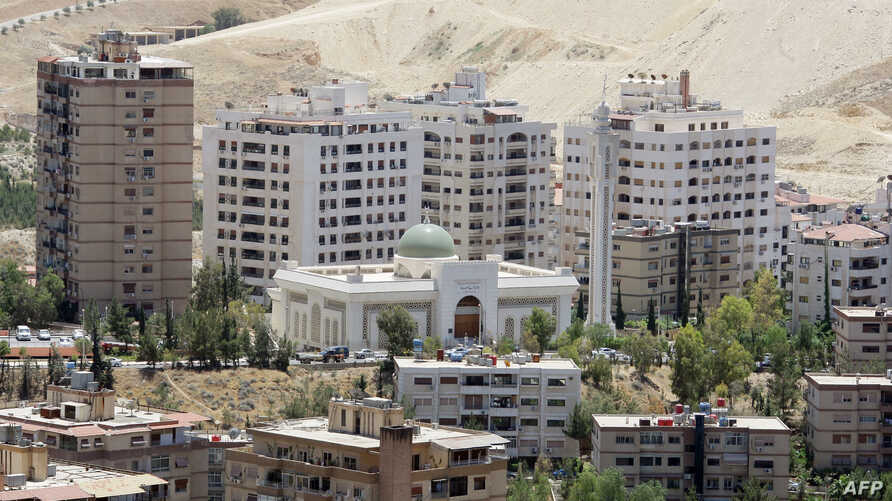 FILE - New buildings are seen in Damascus, where the price of property has been rising sharply, May 20, 2010.