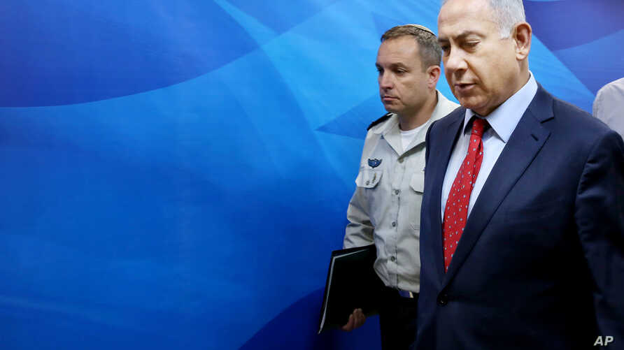 Israeli Prime Minister Benjamin Netanyahu arrives to chair the weekly cabinet meeting in Jerusalem, April 10, 2016.