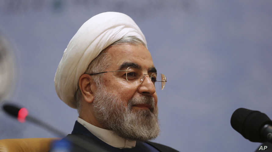 FILE - Iranian President Hassan Rouhani sits while attending the 27th International Islamic Unity Conference in Tehran, Iran, Friday, Jan. 17, 2014.