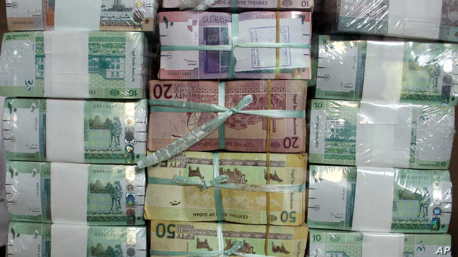 FILE - Sudan's new currency sits behind a window at the central bank in Khartoum, Sudan.