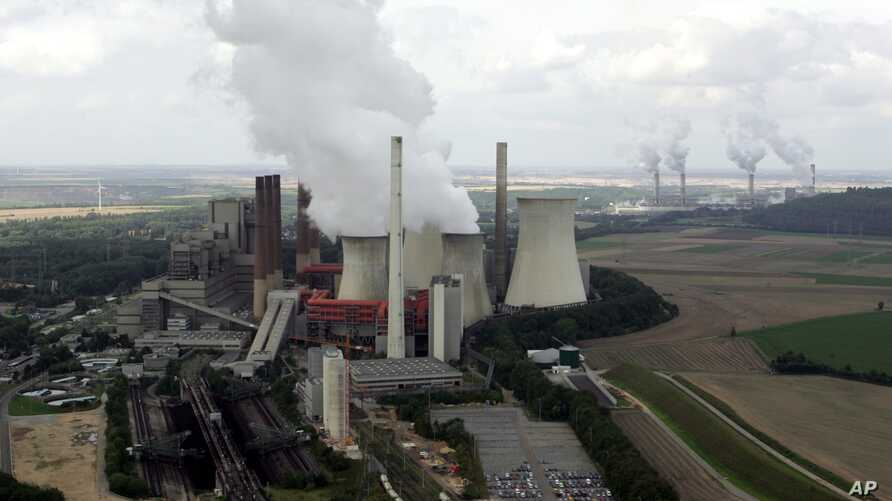 FILE - View to the brown coal power plant of German energy company RWE in Neurath, western Germany, Aug. 27, 2007.