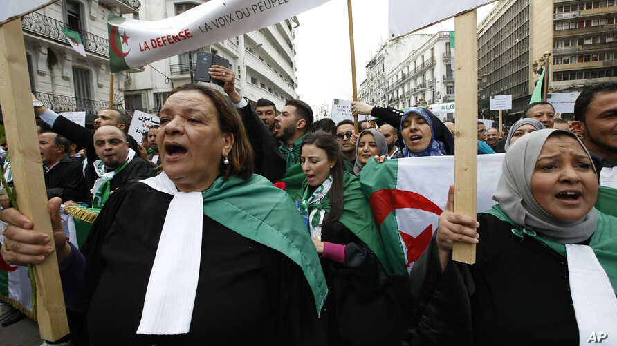 Algerian lawyers march to demand the departure of ailing 82-year-old Algerian President Abdelaziz Bouteflika at the end of his term scheduled on April 28, in Algiers, March 23, 2019.