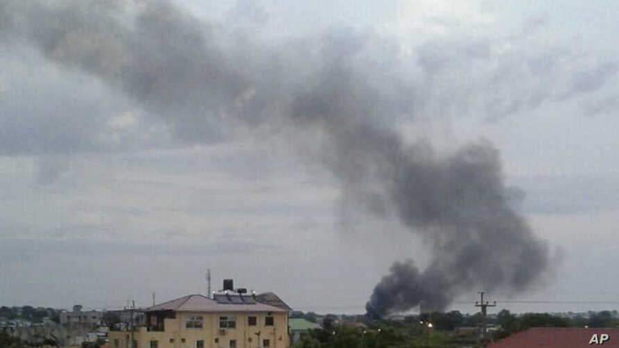 FILE - Black smoke rises above Juba, South Sudan, July 10, 2016. Explosions and heavy weapons gunfire shook the city as clashes between government and opposition forces continued.