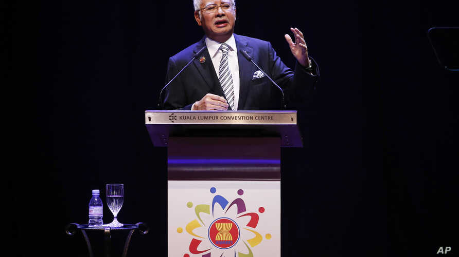 Malaysian Prime Minister Najib Razak speaks at the opening ceremony of the Association of Southeast Asian Nations (ASEAN) summit in Kuala Lumpur, Malaysia, Saturday, Nov. 21, 2015.
