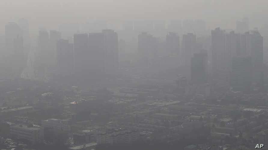 Buildings and houses are covered with a thick haze in Seoul, South Korea, Feb. 26, 2014.