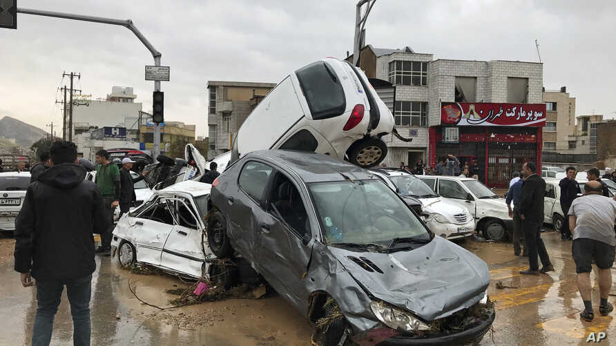 Vehicles are piled up on a street after a flash flood in the southern city of Shiraz, Iran, March 25, 2019.