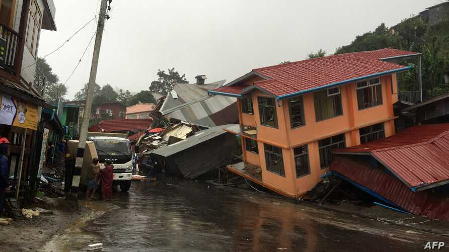 Apartments are destroyed following a landslide due to heavy rain in Harkhar, Chin State of Myanmar, July 30, 2015.