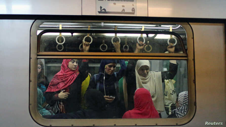Commuters are seen inside the metro at Sadat metro station underneath Tahrir Square in Cairo, Egypt, June 17, 2015.