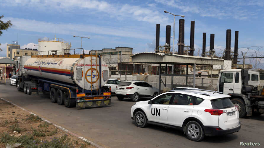 A United Nations vehicle follows a fuel tanker as it arrives at the Gaza power plant, in the central Gaza Strip, Oct. 9, 2018.
