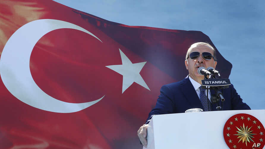 Turkey's President Recep Tayyip Erdogan delivers a speech during an event in Istanbul, Aug. 25, 2017. Invoking national security, Erdogan has spearheaded a crackdown against supporters of influencial cleric Fethullah Gullen, whom he sees as the insti