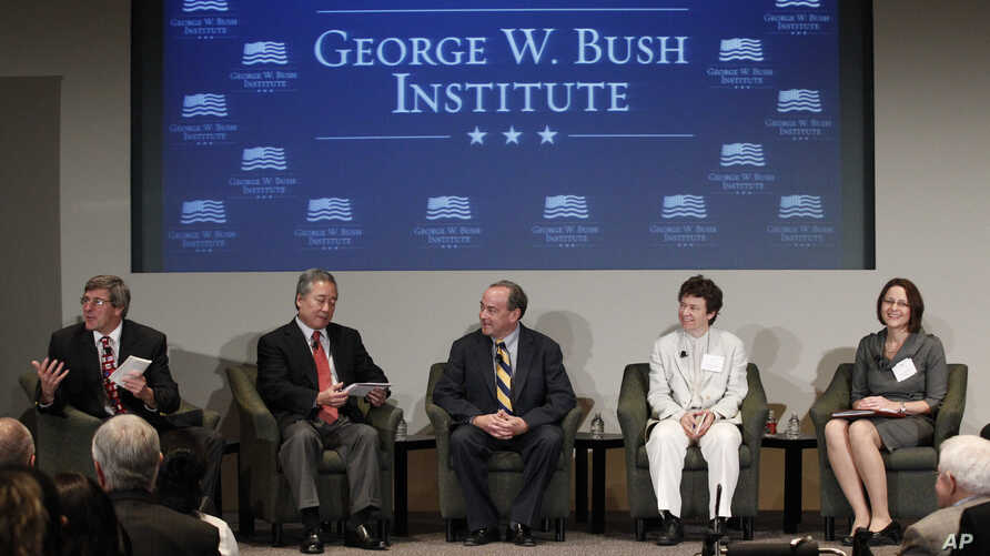 FILE - Stephen Moore, left, leads a panel with, from left, Robert Asahina, Clint Bolick, Jennifer Hunt and Pia Orrenius at the Federal Reserve Bank of Dallas for a conference, Dec. 4, 2012, in Dallas.