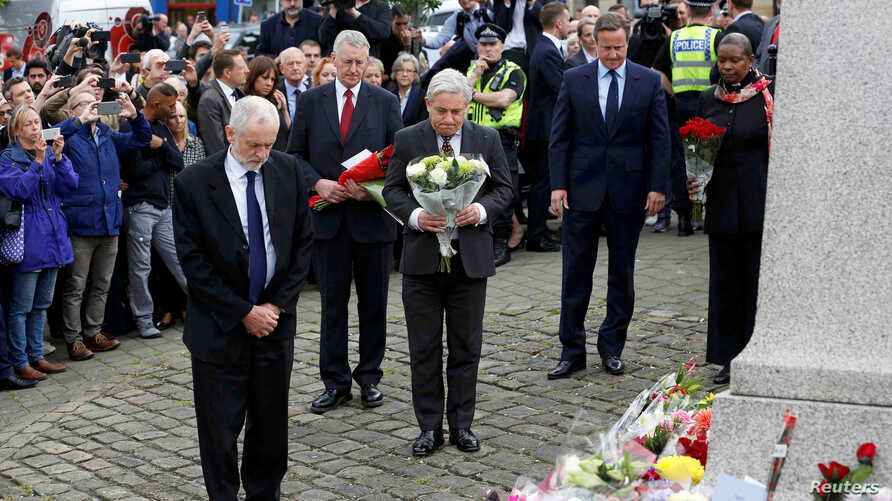 Britain's Prime Minister David Cameron (2nd R) stands with Labour Party leader Jeremy Corbyn (L), John Bercow, Speaker of the House of Commons (C) and Labour MP Hilary Benn (2nd L) as they pay tribute near the scene where Labour Member of Parliament ...