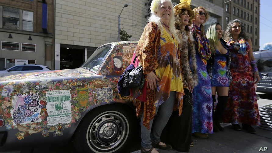 Summer of Love AnniversaryA group of women pose next to a psychedelic Rolls Royce before a ceremony to open an exhibit celebrating the 50th anniversary of the Summer of Love at the California Historical Society, May 12, 2017.