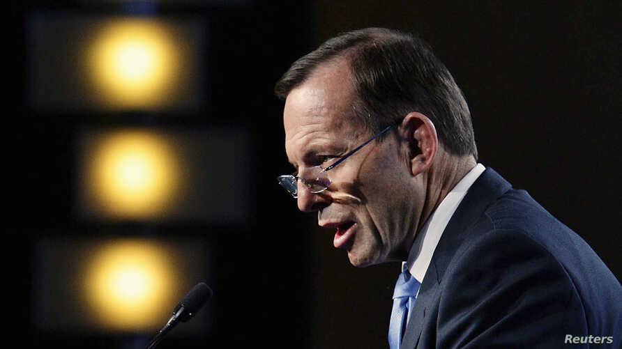 Australian Prime Minister Tony Abbott delivers his keynote speech during the B20 Summit in Sydney, July 17, 2014.