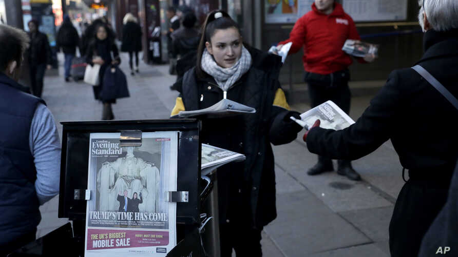The front page of the London Evening Standard newspaper reports on Donald Trump's inauguration as U.S. president, as copies are distributed outside Waterloo train station in London, Jan. 20, 2017.