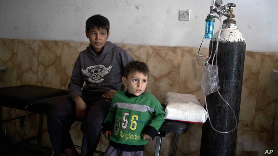Children who have inhaled sulfur fumes wait for treatment at a hospital in Qayyarah, about 31 miles (50 km) south of Mosul, Iraq, Oct. 23, 2016.