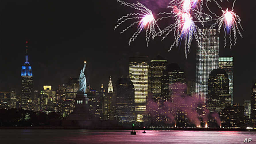 Fireworks go off in New York Harbor to celebrate the 125th birthday of the Statue of Liberty, October 28, 2011.