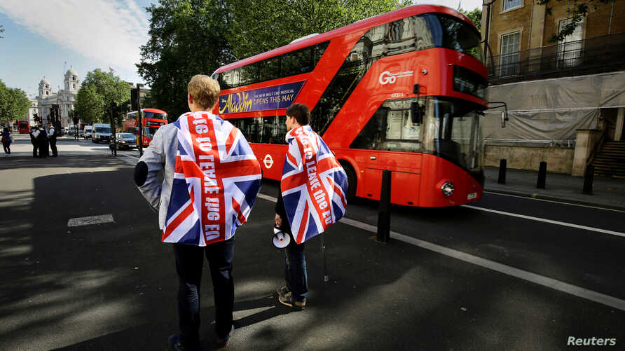 Vote leave supporters stand outside Downing Street in London after Britain voted to leave the European Union, June 24, 2016.