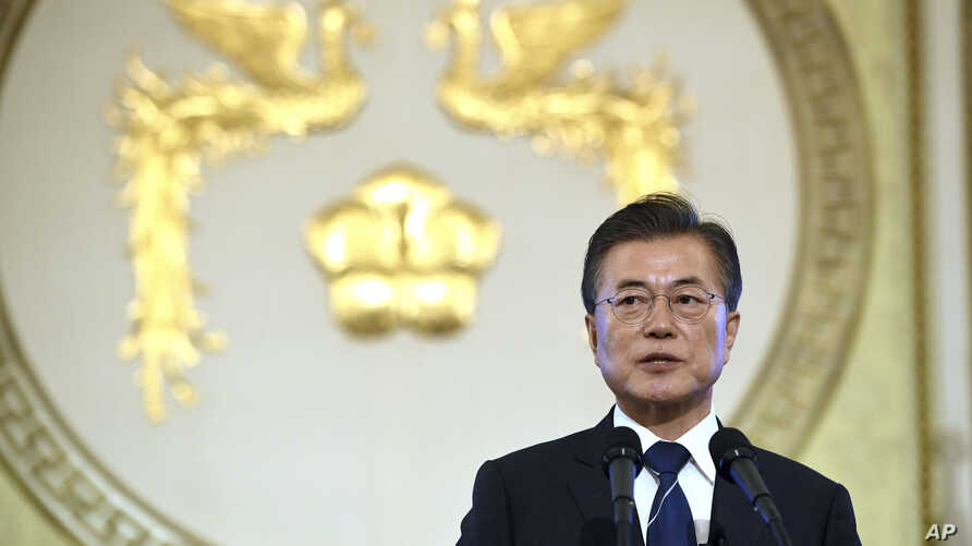 South Korean President Moon Jae-in speaks during a press conference marking his first 100 days in office at the presidential house in Seoul, Aug. 17, 2017. President Moon said Thursday he would consider sending a special envoy to North Korea for talk...