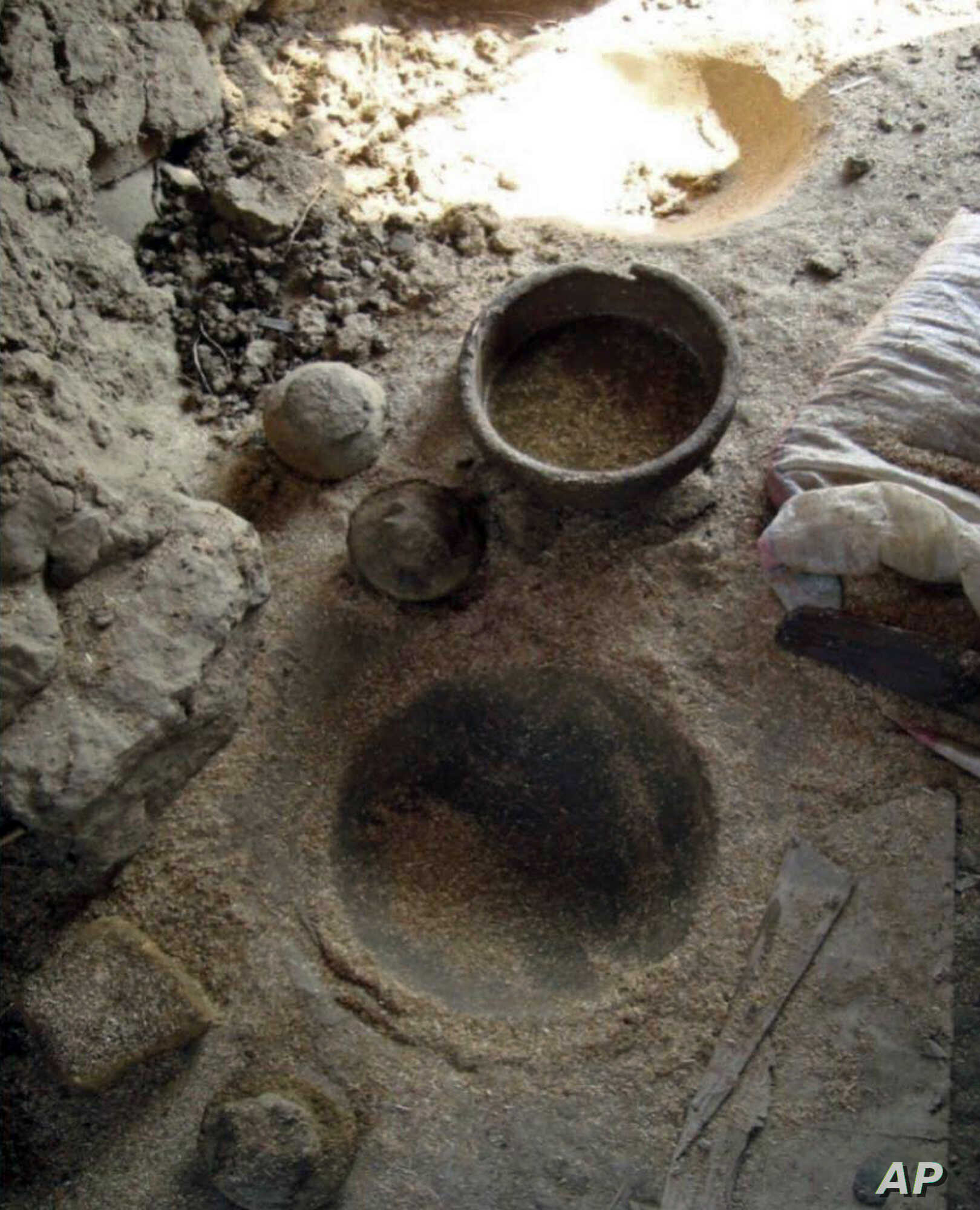 This undated photos provide by the Egyptian Ministry of Antiquities, shows a 4000-year old pottery manufacturing workshop that was recently discovered close to the Nile River in Aswan province, southern Egypt. A statement Thursday July 19, 2018, by t