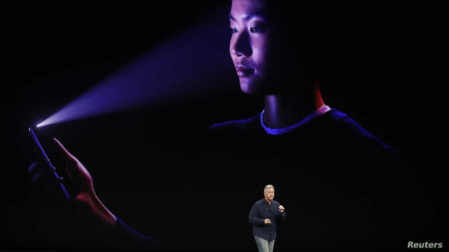 Apple Senior Vice President of Worldwide Marketing, Phil Schiller, introduces the iPhone x during a launch event in Cupertino, California, U.S. September 12, 2017.