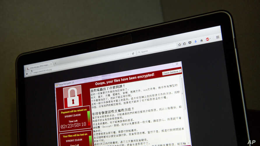 A screenshot of the warning screen from a purported ransomware attack, as captured by a computer user in Taiwan, is seen on laptop in Beijing, May 13, 2017. Dozens of countries were hit with a huge cyberextortion attack Friday that locked up computer