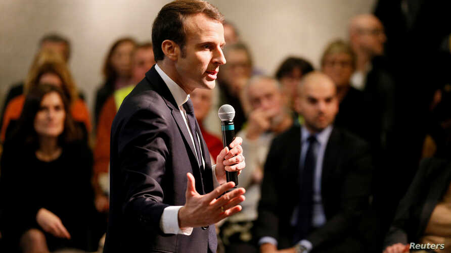"""FILE - French President Emmanuel Macron attends a meeting with local residents as part of the """"Great National Debate"""" in Bourg-de-Peage near Valence, France, Jan. 24, 2019."""