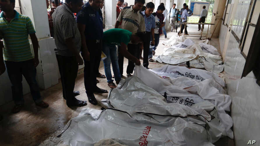 Bodies of victims are placed at a makeshift morgue at a hospital after a fire broke out at a packaging factory in the Tongi industy area outside Dhaka, Bangladesh, Sept. 10, 2016.
