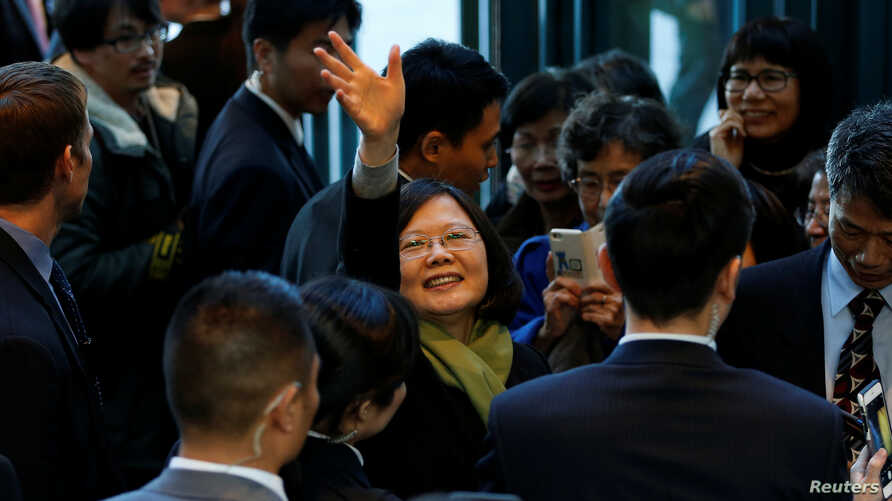 Taiwan President Tsai Ing-wen waves to supporters as she leaves a hotel for her return to Taiwan after her visit to Latin America in Burlingame, Calif., Jan. 14, 2017.