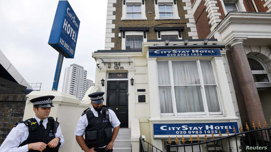 Police officers stand outside the City Stay Hotel used by Alexander Petrov and Ruslan Boshirov; who have been accused of attempting to murder former Russian spy Sergei Skripal and his daughter Yulia; in London, Britain September 5, 2018.