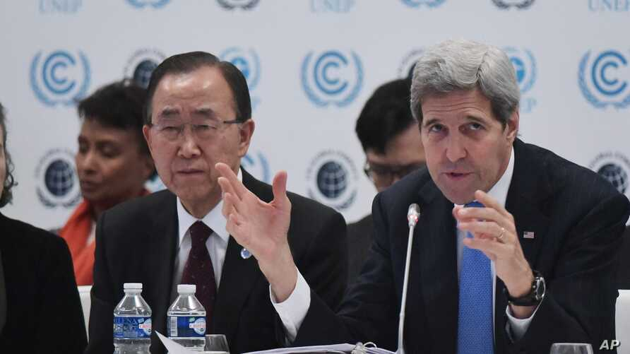 US Secretary of State John Kerry, right, delivers a speech as United Nations Secretary General Ban Ki-moon looks on during the Caring for Climate Business Forum event as part of the COP 21 United Nations conference on climate change, Dec. 8, 2015 in