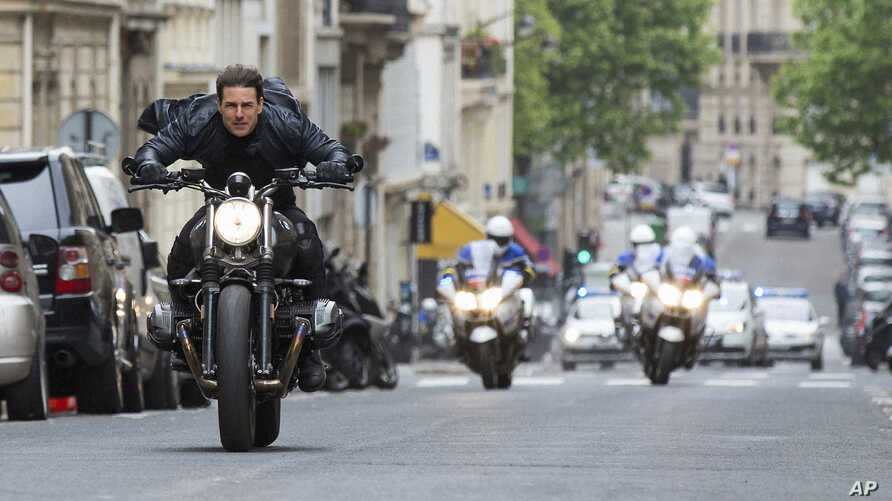 "FILE - This image released by Paramount Pictures shows Tom Cruise in a scene from ""Mission: Impossible - Fallout."" Tom Cruise has outrun Winnie-the-Pooh at the box office. ""Mission: Impossible -- Fallout"" topped ticket sales for the second straight w"