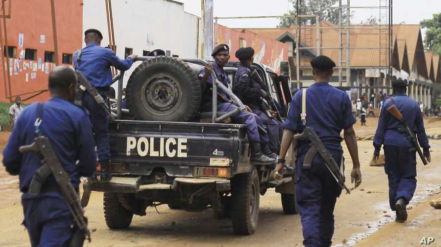 Congolese police move to quell protests in the eastern Congolese town of Beni, Dec. 28, 2018.