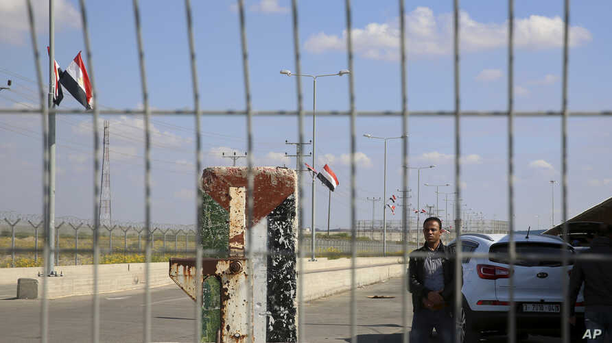 An employee of the Palestinian Authority stands guard on the Palestinian side of the Erez checkpoint between Israel and Gaza, at Beit Hanoun, Gaza Strip, Nov. 1, 2017. The Islamic militant Hamas group has handed over control of Gaza's border crossing