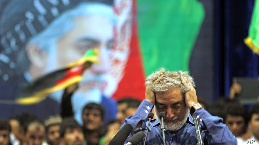 Afghan presidential candidate Abdullah Abdullah runs his hands through his hair as he pauses in addressing his supporters in Kabul, Afghanistan, Tuesday, July 8, 2014.