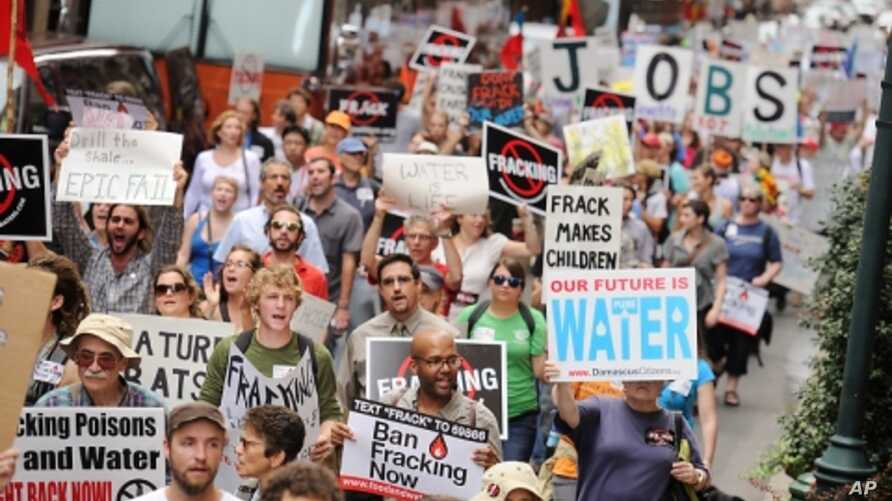 """Citizens march against fracking at the """"Shale Gas Outrage Rally"""" in Philadelphia."""