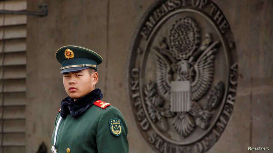 FILE - Paramilitary police officer guards the entrance to the U.S. embassy in Beijing, China, April 5, 2018.