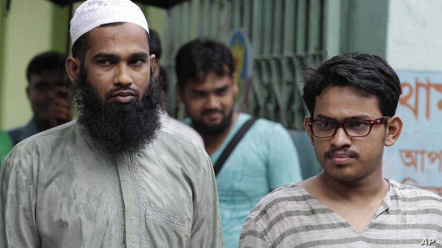 Suspected Muslim militants Saad-al-Nahin, right, and Masud Rana, who were arrested in the last week's killing of a secular blogger, stand before the media in Dhaka, Bangladesh, Friday, Aug. 14, 2015.
