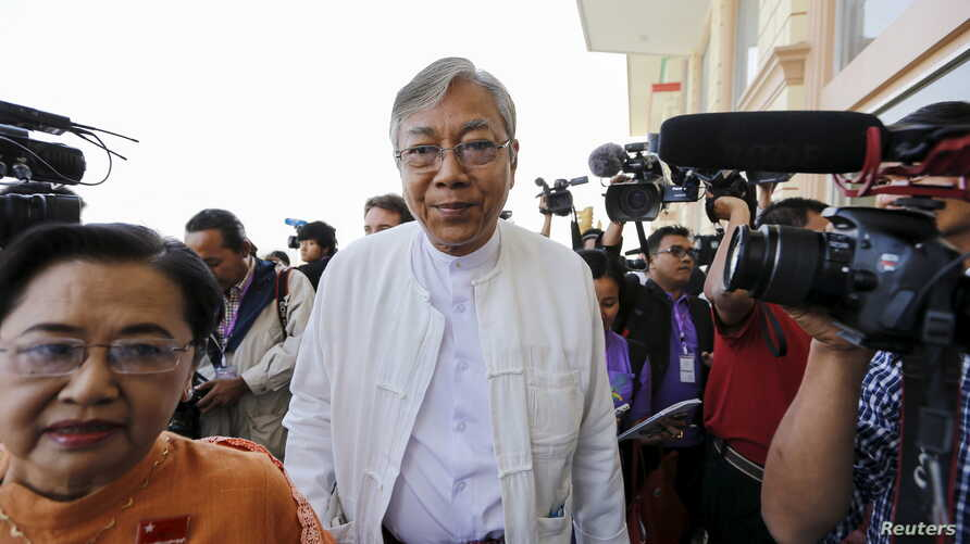 FILE - Htin Kyaw, nominated as Myanmar's National League for Democracy presidential candidate for the lower house of parliament, arrives at Parliament in Naypyitaw, Feb. 1, 2016.