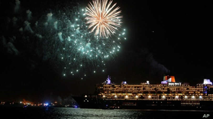 The Queen Mary 2 cruise ship is seen near a fireworks display January 13, 2011 in New York City.