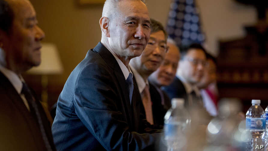 Chinese Vice Premier Liu He, center, accompanied by other Chinese officials, begins talks with U.S. Trade Representative Robert Lighthizer at the Executive Office Building on the White House Complex, Jan. 30, 2019.