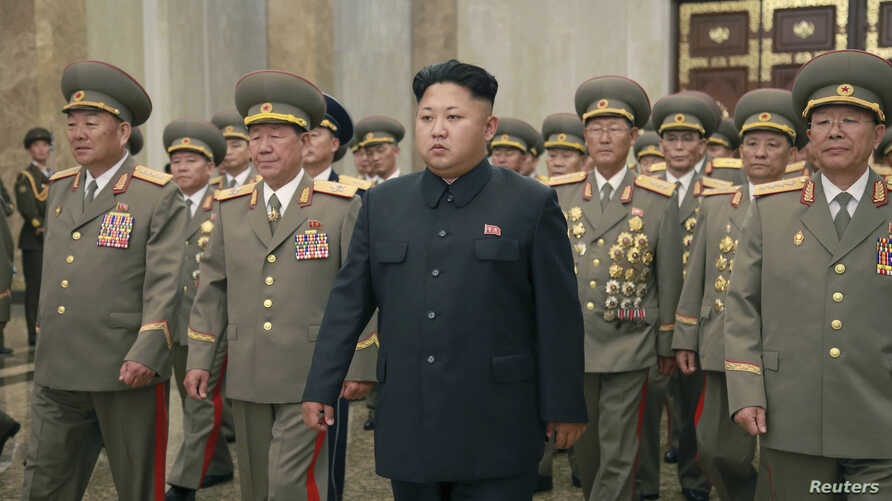 North Korean leader Kim Jong Un, with troops, visits the Kumsusan Palace on the anniversary of the armistice signing that ended the Korean War. Photo released by North Korea's Korean Central News Agency in Pyonghyang July 27, 2014.