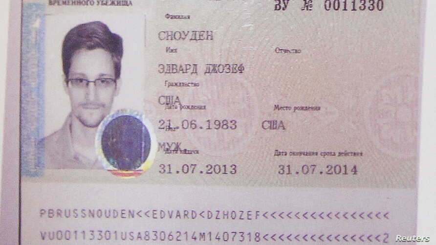 Fugitive former U.S. spy agency contractor Edward Snowden's new refugee documents granted by Russia is seen during a news conference in Moscow Aug. 1, 2013.