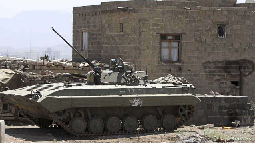 An armored military vehicle is seen near the vicinity of the presidential palace in Sana'a, Yemen, April 2, 2015.