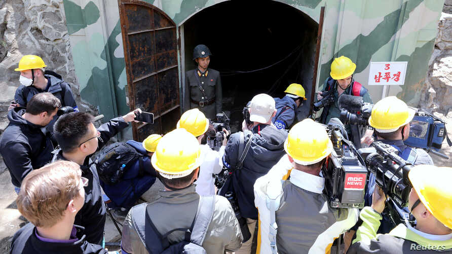 Journalists look around the third tunnel of Punggye-ri nuclear test ground before it is blown up during the dismantlement process in Punggye-ri, North Hamgyong Province, North Korea, May 24, 2018.