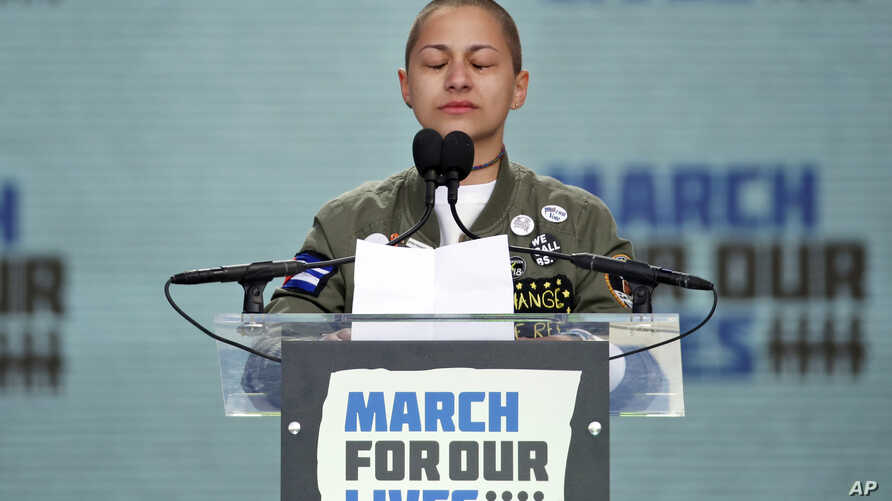 FILE - Emma Gonzalez, a survivor of the mass shooting at Marjory Stoneman Douglas High School in Parkland, Fla., closes her eyes and cries as she stands silently at the podium for the amount of time it took the Parkland shooter to go on his killing s