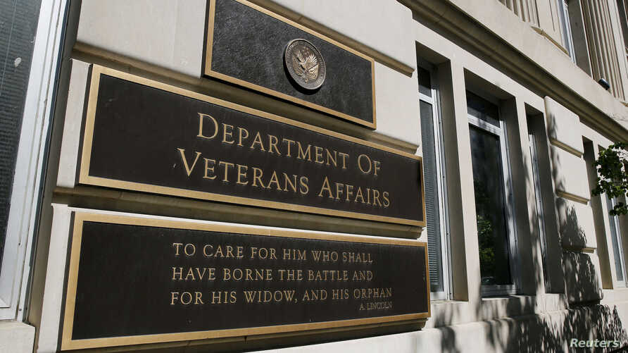 FILE - The sign of the Department of Veteran Affairs is seen in front of the headquarters building in Washington, May 23, 2014.